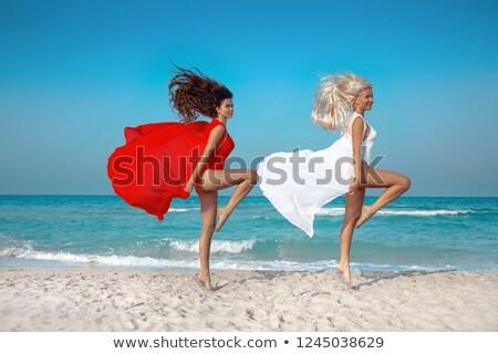 girl with red sarong on white sand stock photo © dolgachov
