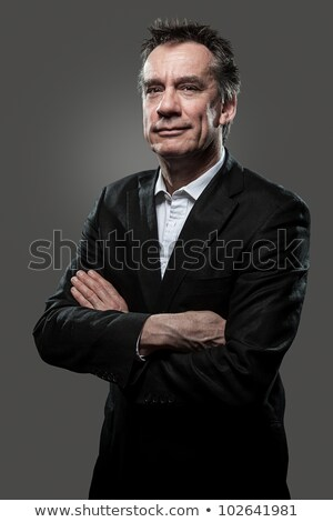 Smiling Business Man Arms Folded Grey Background High Contrast stock photo © scheriton