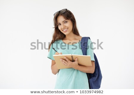 pretty college student posing with her notebook stock photo © stockyimages