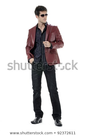 ... Handsome young businessman in sunglasses. Full body isolated on white