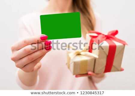 young girl holding a gift on christmas day stock photo © photography33