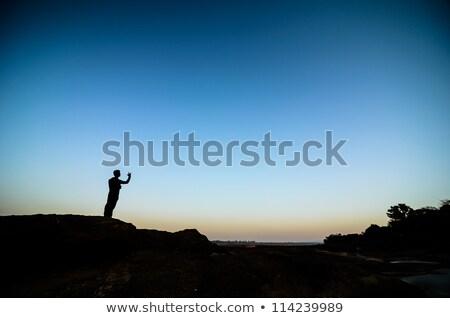 Silhouette man Sampanbok in Mekong River, Ubon Ratchathani, Thai Stock photo © sweetcrisis
