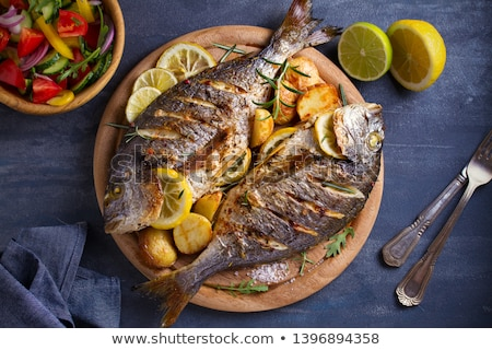 fresh fish on dish with vegetables stock photo © shutswis