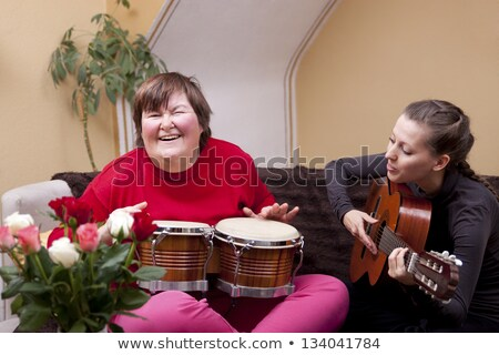 Woman playing bongo Stock photo © photography33