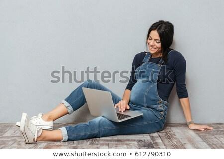a pregnant woman over a computer stock photo © photography33