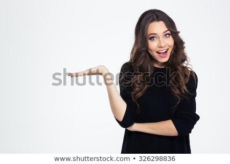 Gyönyörű boldog fiatal nő tart üres hely pálmafák Stock fotó © rosipro