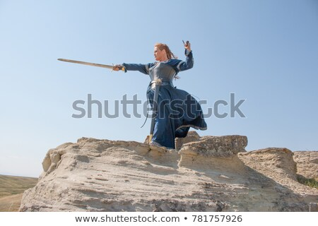 Stock photo: Woman in the medieval costume holding a sword