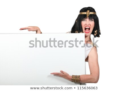Woman dressed as Cleopatra pointing to a blank sign Stock photo © photography33