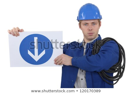 Electrician holding directional road sign Stock photo © photography33