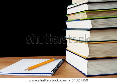 pencil on notebook near pile of books on white stock photo © inxti