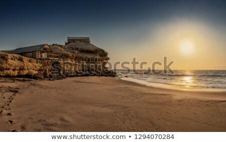 Strand zonsondergang hoofd wolken natuur Stockfoto © flotsom