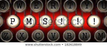 pms premenstrual syndrome on red button stock photo © tashatuvango