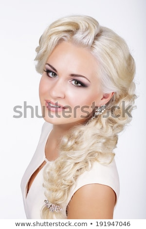 Sophistication. Fashionable Woman with Frizzy Hair with Earrings. Curly Hairstyle Stock photo © gromovataya