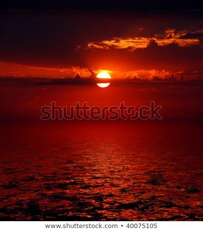 bloody sunrise over sea stock photo © mikko