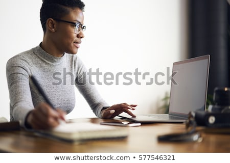 Female assistant reviewing file Stock photo © stockyimages