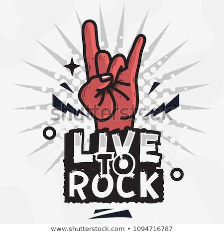 Heavy metal diavolo segno di mano rock rotolare Foto d'archivio © fizzgig