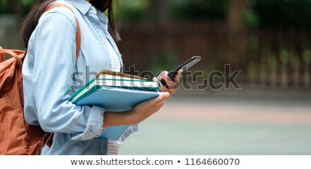 Student with bag, phone and books going school stock photo © lunamarina