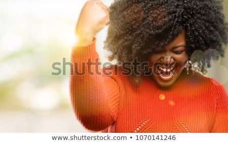 Excited victorious woman expressing success Stock photo © stockyimages