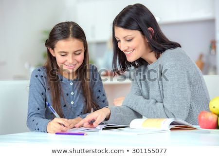 Mother and daughter doing homework Stock photo © photography33