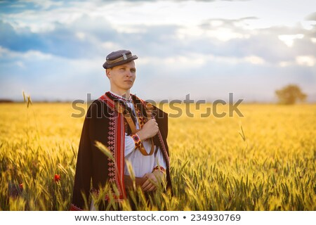 Сток-фото: Man Wearing A Folk Ukrainian Costume Jumping