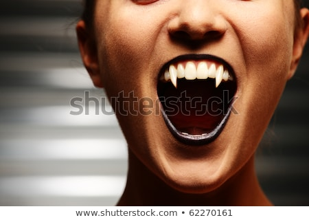 woman vampire with fangs on a dark background Stock photo © stepstock