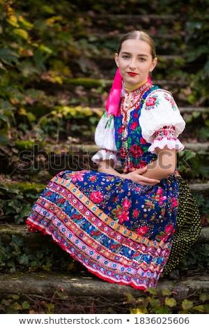 Attractive man wearing a folk ukrainian dress Stock photo © stepstock