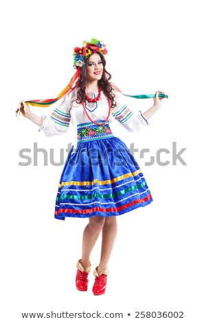 attractive woman wearing a folk ukrainian dress stock photo © stepstock