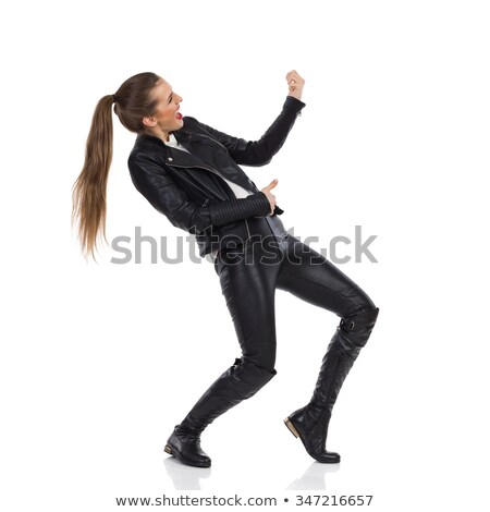 side view of a young beauty woman in leather jacket stock photo © feedough