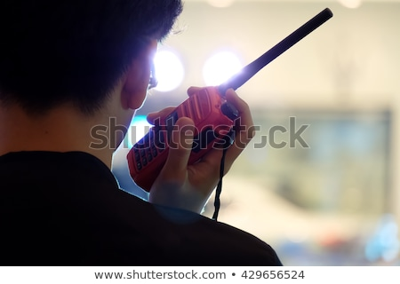 Man talking by walkie talkie radio Stock photo © blasbike