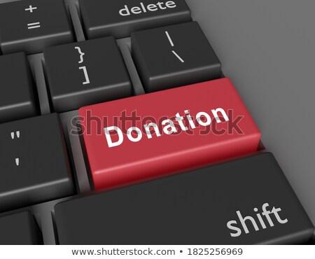 Adományoz piros billentyűzet gomb pénz kéz Stock fotó © tashatuvango