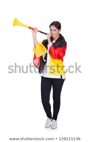 Happy Female German Supporter Blowing Vuvuzela Stock photo © AndreyPopov