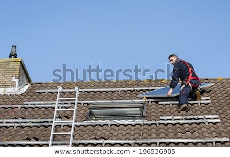 man · zonnepaneel · dak · metaal · bouw · huis - stockfoto © compuinfoto