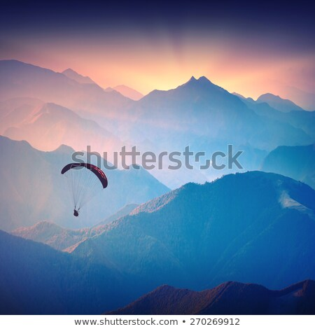 Сток-фото: Paraglide Shadow Figure Over Alps Peaks