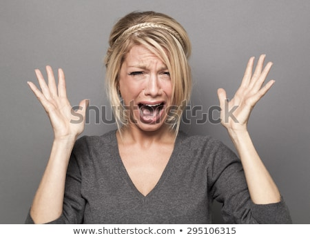 Woman fed up with long hair screaming Stock photo © dash