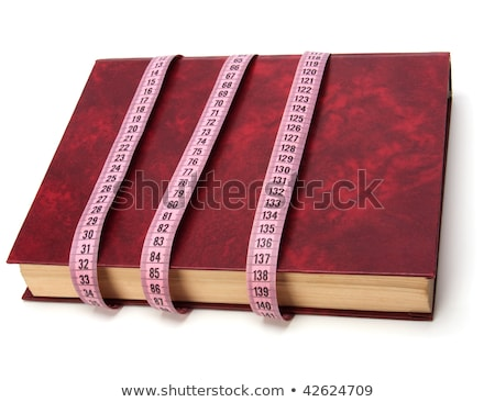 tape measure wrapped around book isolated on white background stock photo © natika