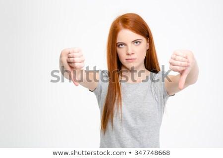 Fiatal nő mutat hüvelykujjak lefelé felirat mindkettő Stock fotó © bmonteny