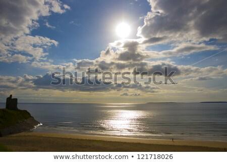 beautiful yellow sun over the ballybunion beach and castle stock photo © morrbyte