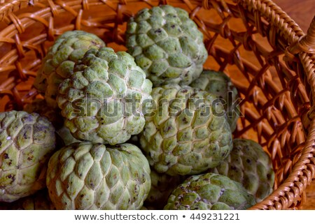 Custard apple with leaves in wicker basket Stock photo © supersaiyan3