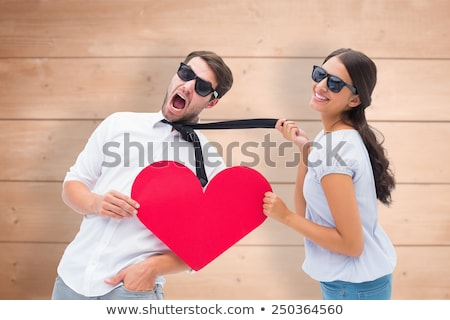 Woman pulling her boyfriend close to her Stock photo © feedough