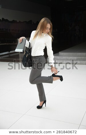 business woman walking on high heels feeling pain at feet stock photo © diego_cervo