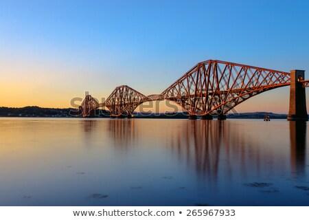 Trilho ponte pôr do sol escócia estrada edifício Foto stock © elxeneize