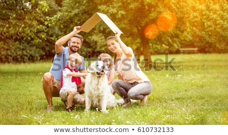 Happy family with their dog in the park Stock photo © wavebreak_media