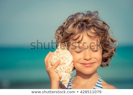 tanned girl with shell Stock photo © adrenalina
