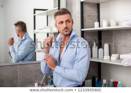 красивый мужчина одевание рубашку портрет глядя камеры Сток-фото © deandrobot