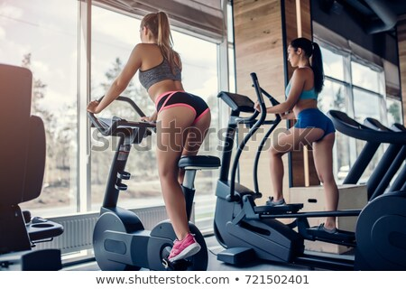 smiling young woman on training apparatus Stock photo © Paha_L