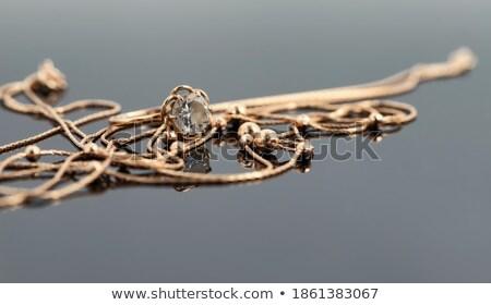large diamonds or gemstones on reflected surface stock photo © arsgera