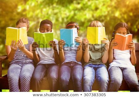 Mädchen Lesung Baum ziemlich Buch blau Stock foto © ndjohnston
