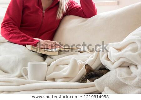 Kobieta piżama posiedzenia bed uśmiechnięty Zdjęcia stock © dash