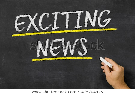 Exciting news written on a blackboard Stock photo © Zerbor