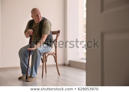 Triste homme salle vide main visage affaires Photo stock © konradbak